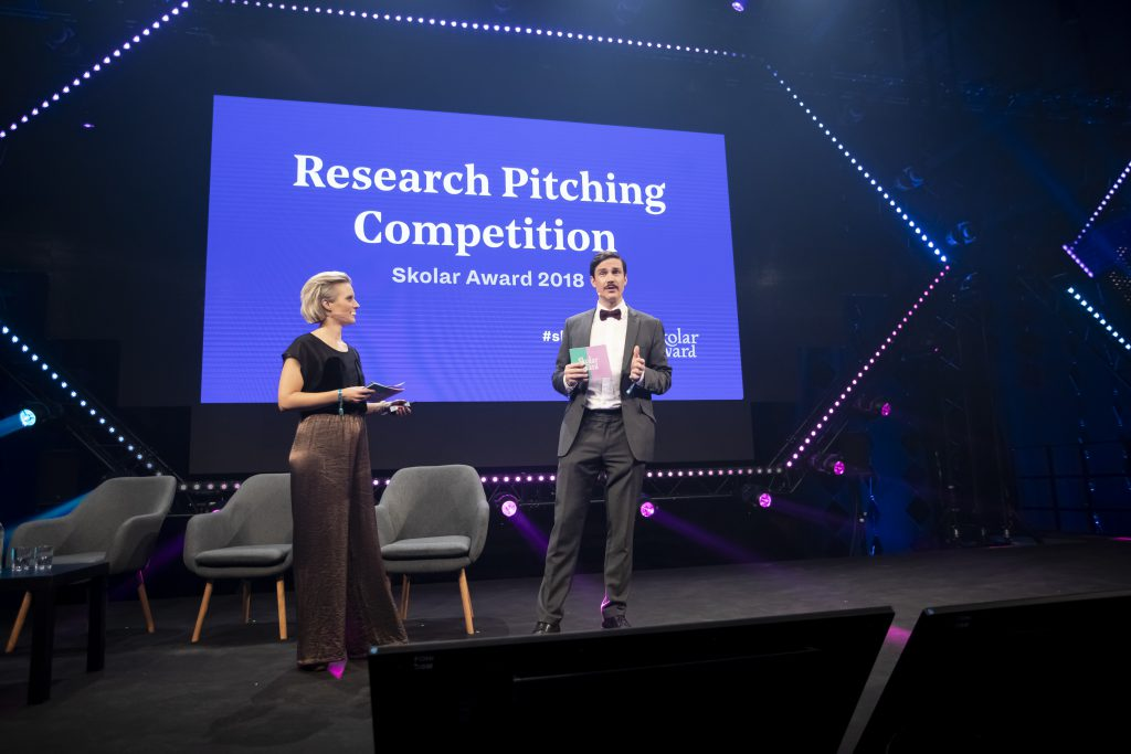 The hosts Aurora Airaskorpi and Timo Stewart at Research Pitching Finals at Slush