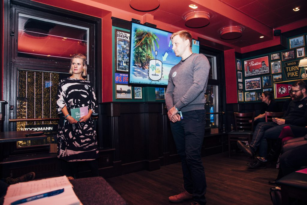 Finalist Joosu Kuivanen receives comments at Skolar Award Premiere at O'Learys